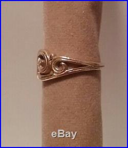 James Avery 14k yellow gold swirl wave ring